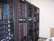 Multiple racks of servers, and how a datacenter commonly looks.